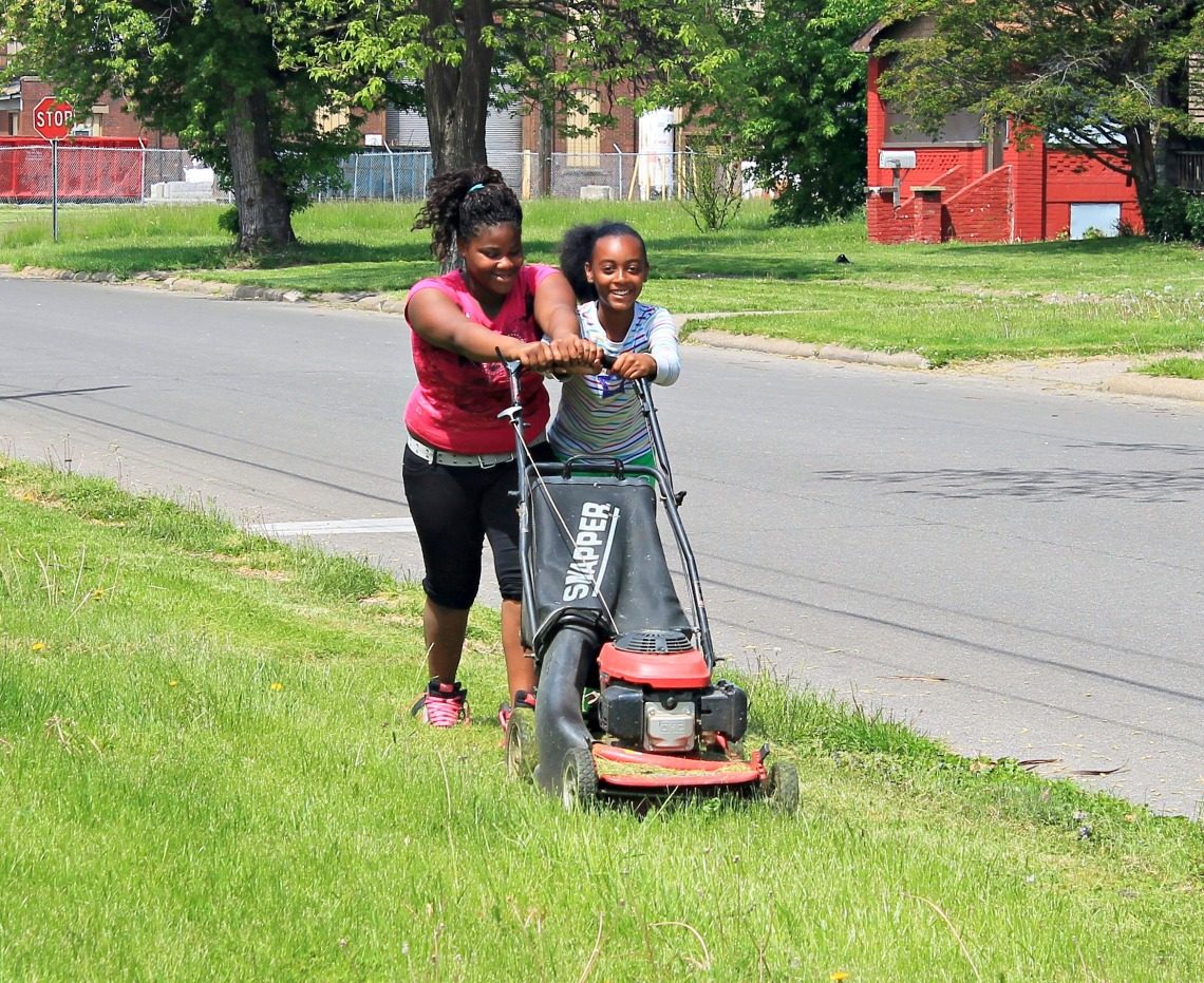 Pride Day S.M.B.C. Young Motivation Girls Club mowing