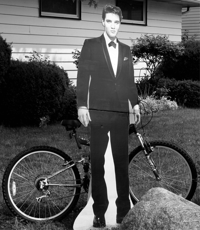 elvis on the corner w bike bw
