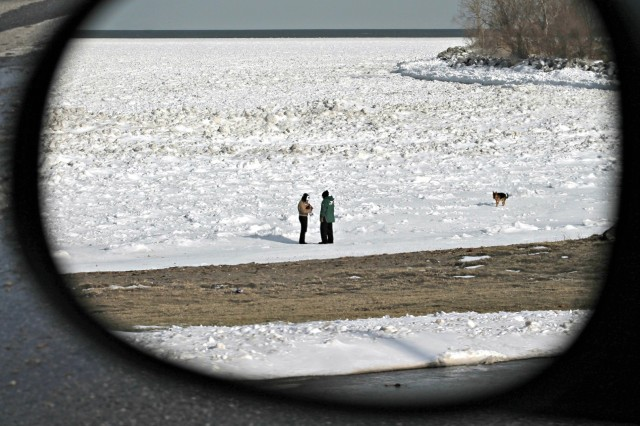 on frozen lake in rearview mirror