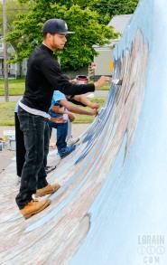 """Repainiting the """"Lorain Pride"""" mural at Pawlak Park"""