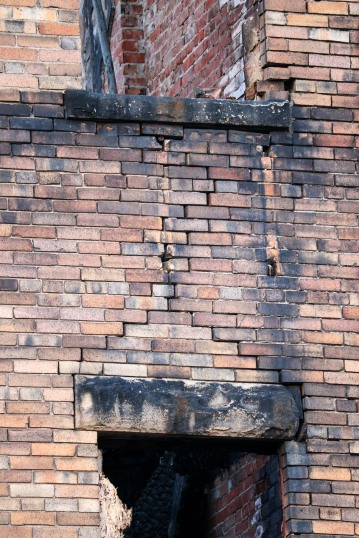 Fire damage to bricks, W wall