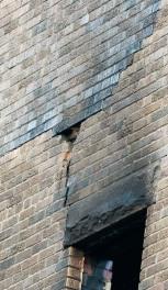 Fire damage to bricks, N wall