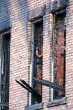Unusual piping seen on one 2nd floor window, N wall