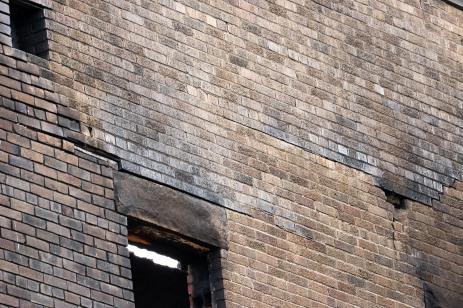brick damage N wall