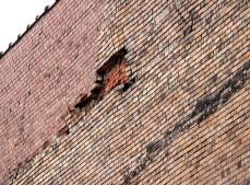 brick damage S wall