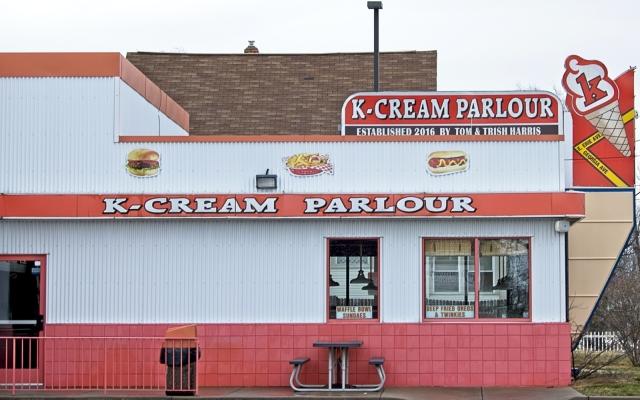 Neighborhood ice cream shop painted orange and white.