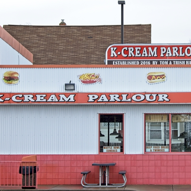 Neighborhood ice cream shop painted orange and white.